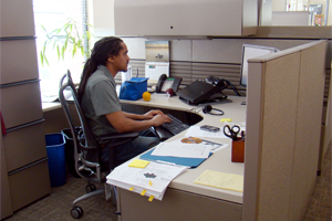 An office worker sitting at a desk in one of Friends Center's open-plan office suites