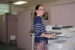 An office worker uses the shared copier in one of Friends Center's open-plan office suites.