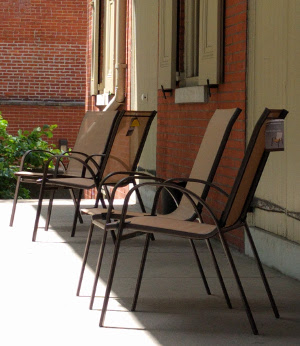 Chairs on the front porch of the Race Street Quaker Meetinghouse